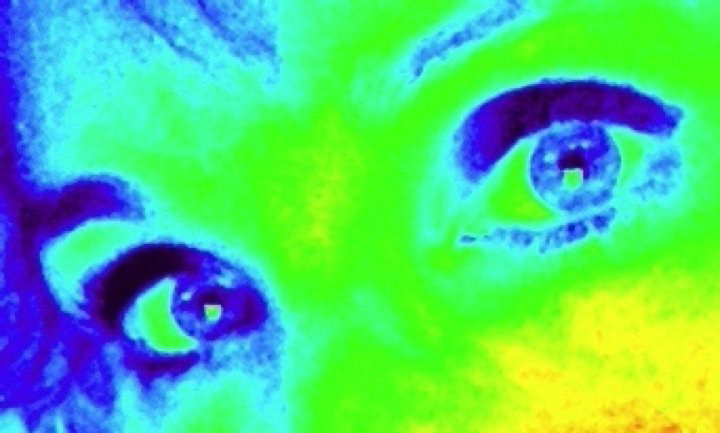 Womans eyes with a heat-map filter to alter coloring