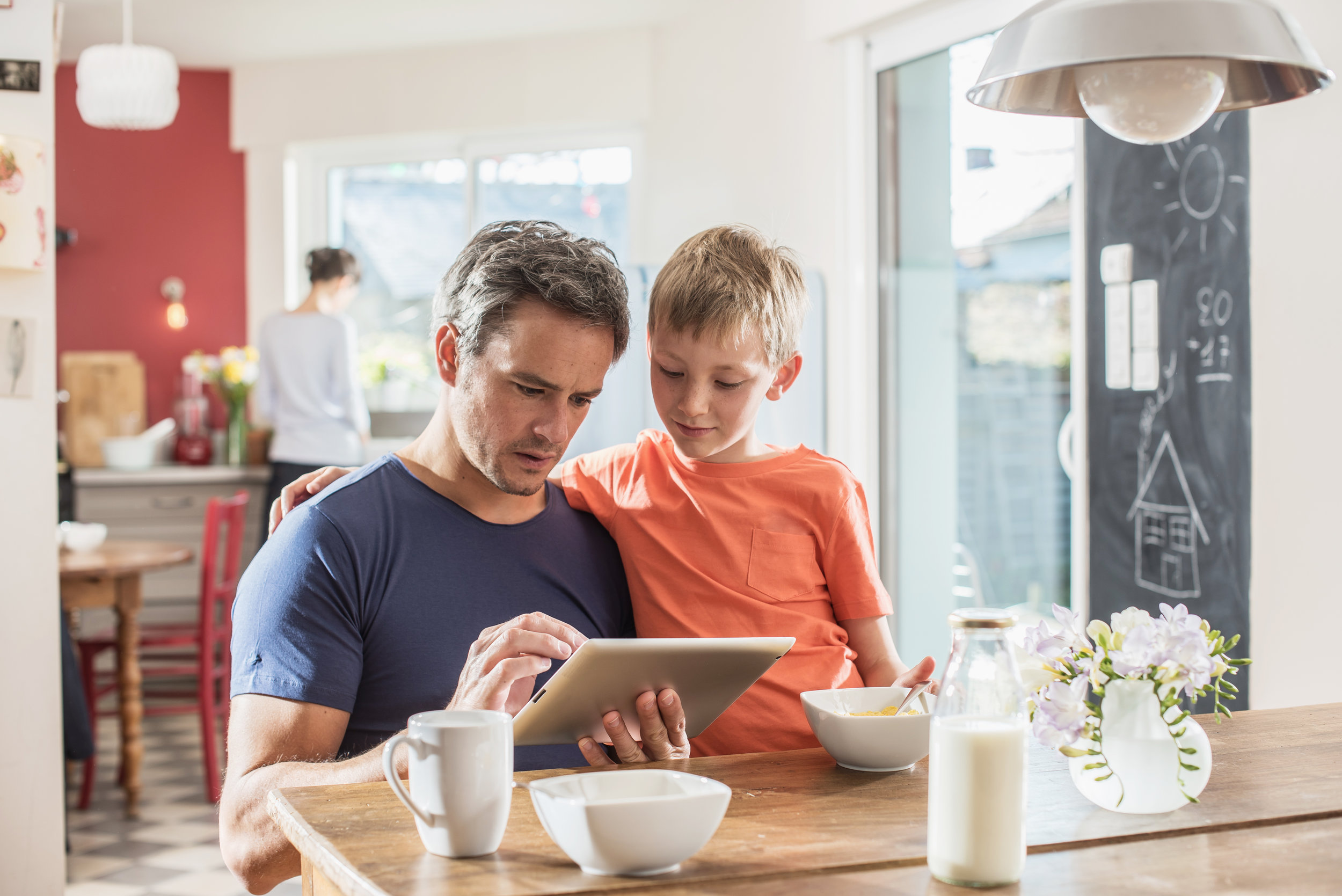 Father showing his son a webpage which features a Chatbot