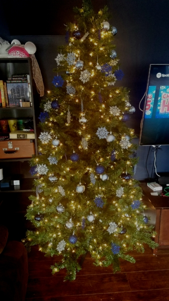 Christmas Tree decorated with twinkle lights, bulbs and snowflake ornaments
