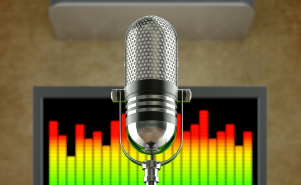 Image from Search Engine Journal. Microphone in front of podcast recording equipment.
