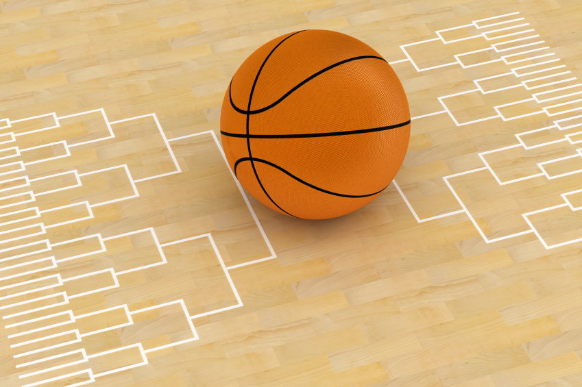 Basketball on basketball court with brackets painted on the floor