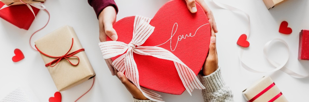 Hands holding a box of Valentine's day chocolate
