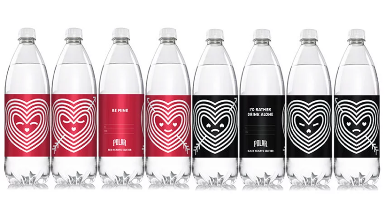 Polar seltzer bottles. Some bottles have red, festive labels for Valentine's day and other have black, disdainful labels for those who don't like the holiday.