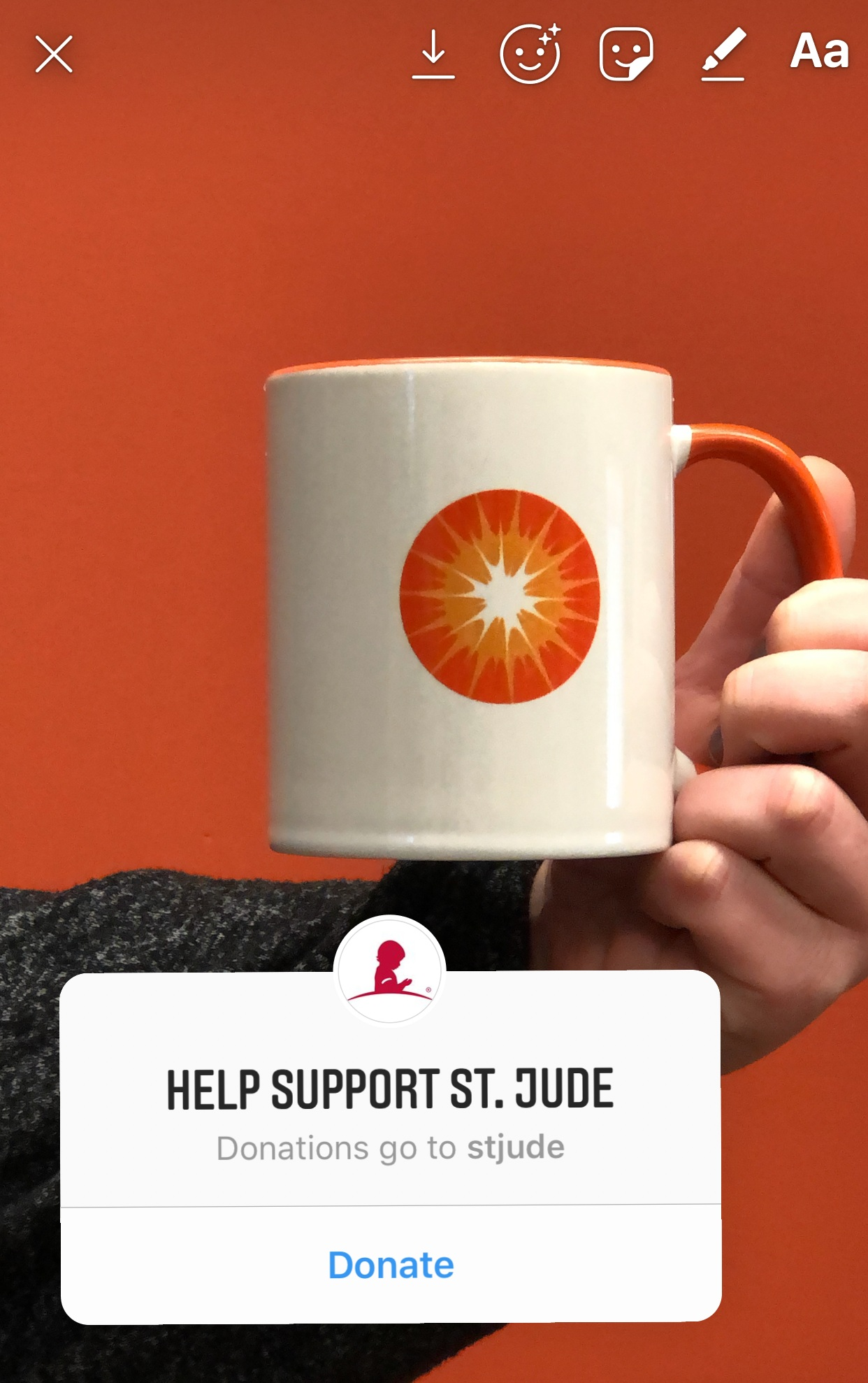 """Sparkshoppe Coffee Mug in Instagram story with """"Help Support St. Jude"""" donation sticker overlay"""