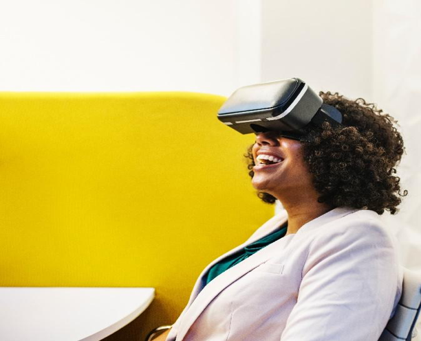 Woman smiling while using a virtual reality headset.