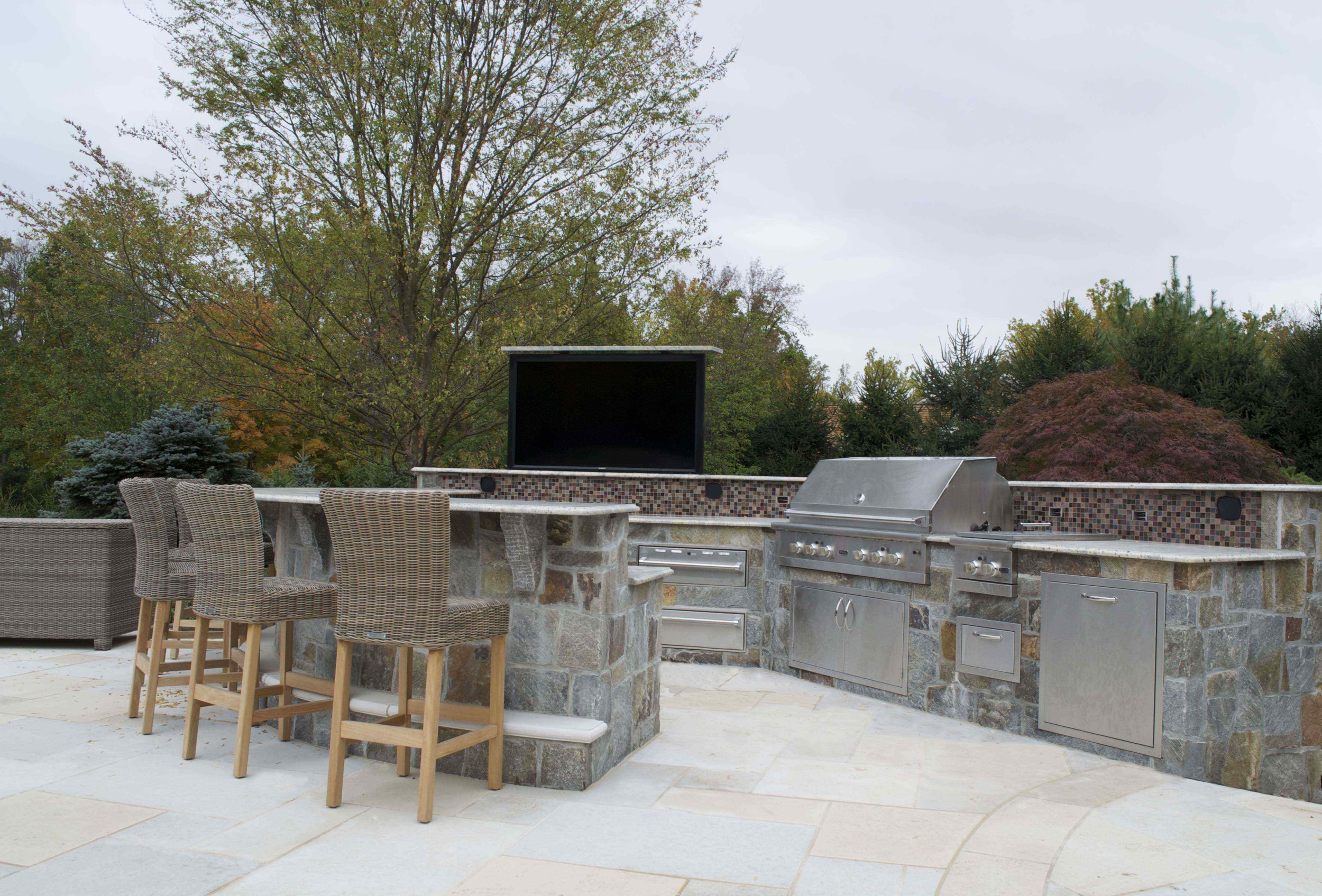 Luxury outdoor kitchen design with 60 inch TV on lift- Bergen County Northen NJ.jpg
