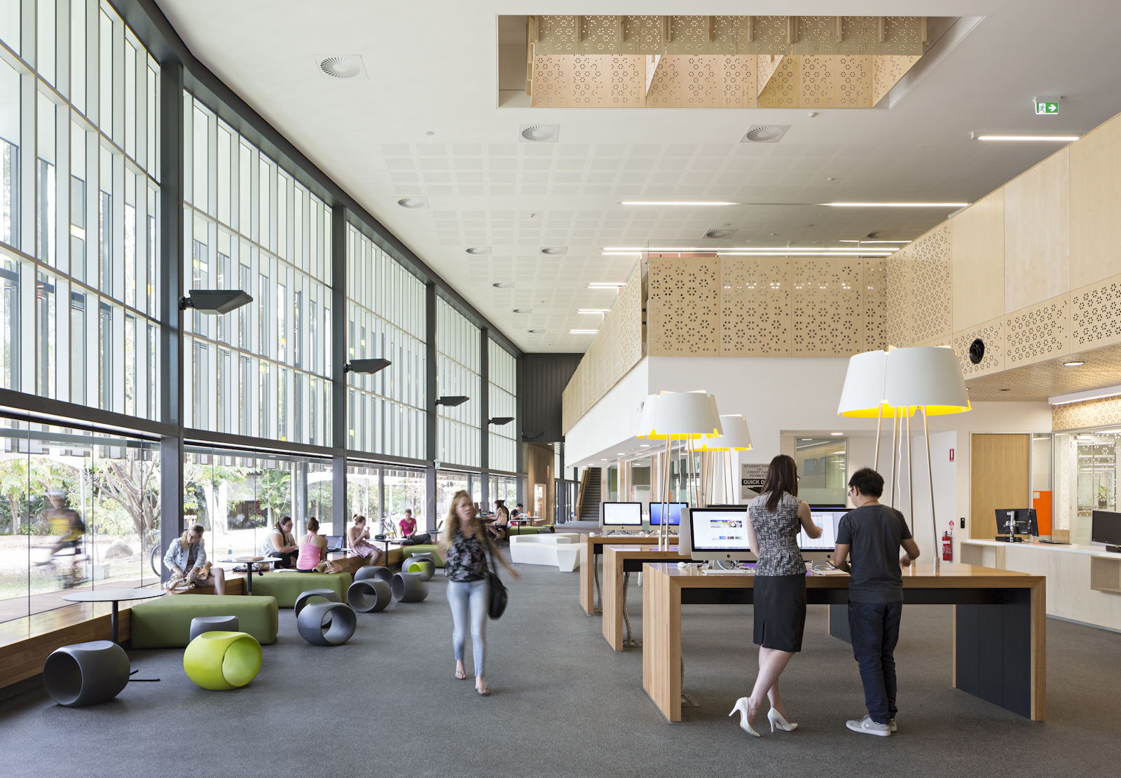 The Student Hub - Student services re-imagined as a flexible,dynamic space that can also be used as a social learning space in non peak times. A three metre fan enables airconditioning to operate at higher temperatures and reduce condensation on the facade.