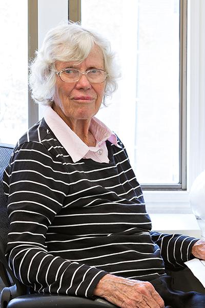 Beth Wilson,  Director
