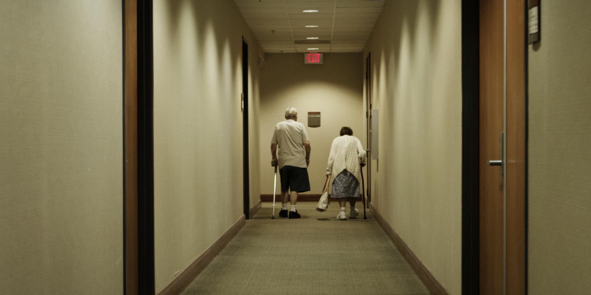 8_990_P_Joe walk down hallway.jpg