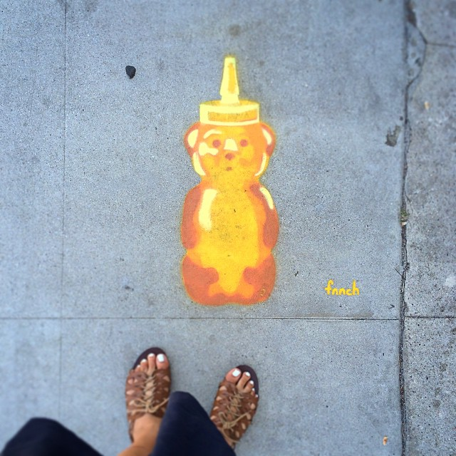 Street Artist Fnnch, seen around the corner from Blue Bottle Coffee in the Art's District