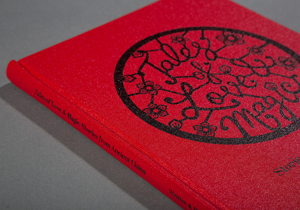 The bright red buckram cover features custom lettering inspired by Chinese paper cutting and lattice windows.