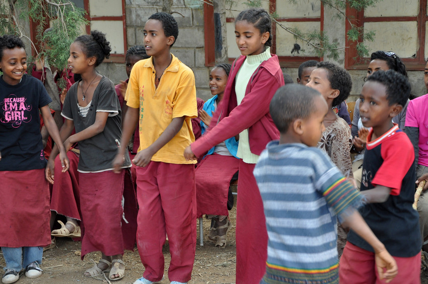 Young ethiopians take part in dance activity advocating against child marriage (CREDIT: PLan)
