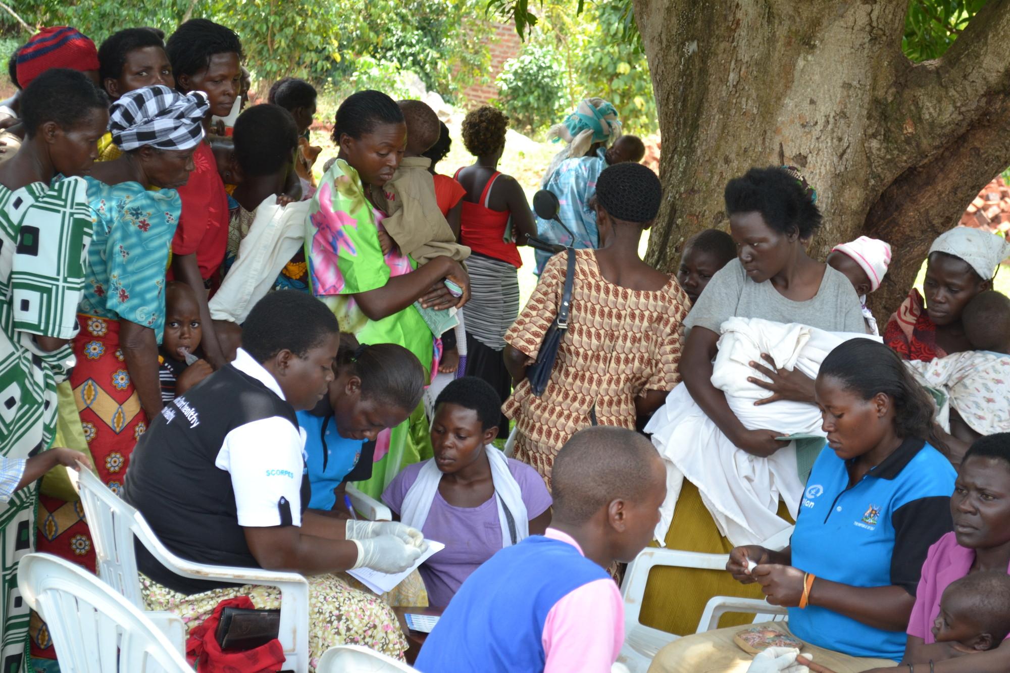 Women await HIV testing in Uganda [Credit: Plan]