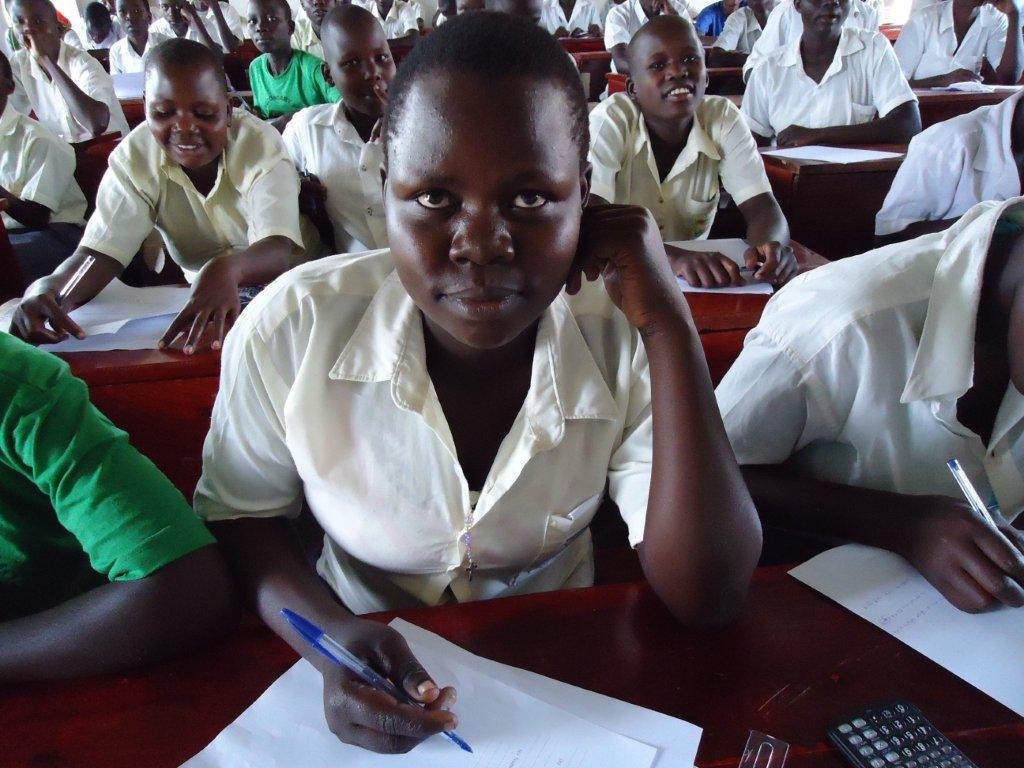 """""""My mother refused to buy me any sanitary pads"""" - Christine, 17, from Uganda [Credit: Plan]"""