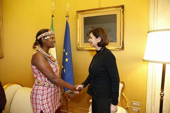 Nice Nailentei Leng'ete (Left)- Amref Ambassador with Laura Boldrini (Right) handshaking during a private meeting in Italy. [Photo Credit: Nice Leng'ete]