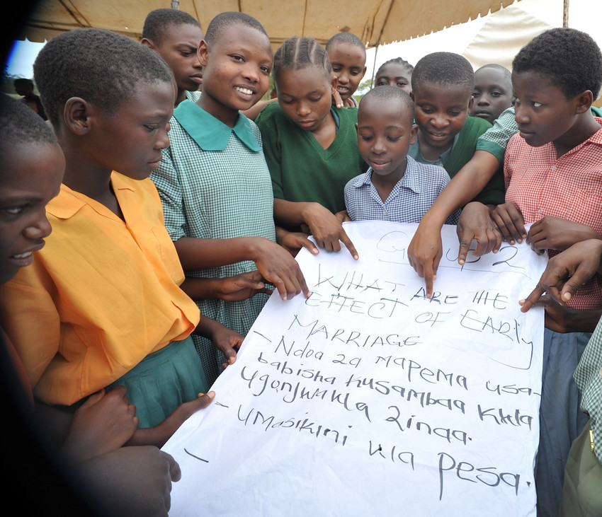 Children take part in group discussion on the effects of early marriage at event in Kilifi [CREDIT: Plan International]