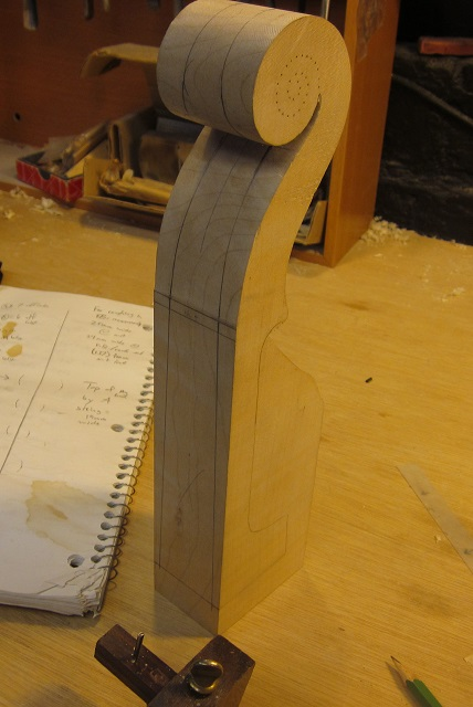 Now I lay out the cuts to make the scroll and neck for the violin.