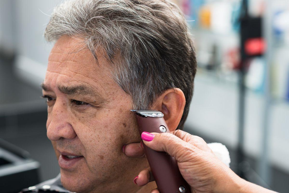 Man getting a haircut at Ultra Beauty Salon