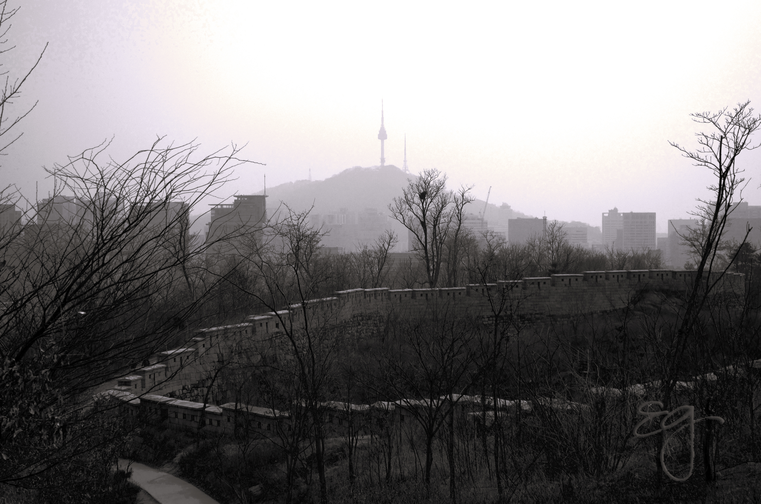 Seoul Fortress with Seoul Tower in the haze