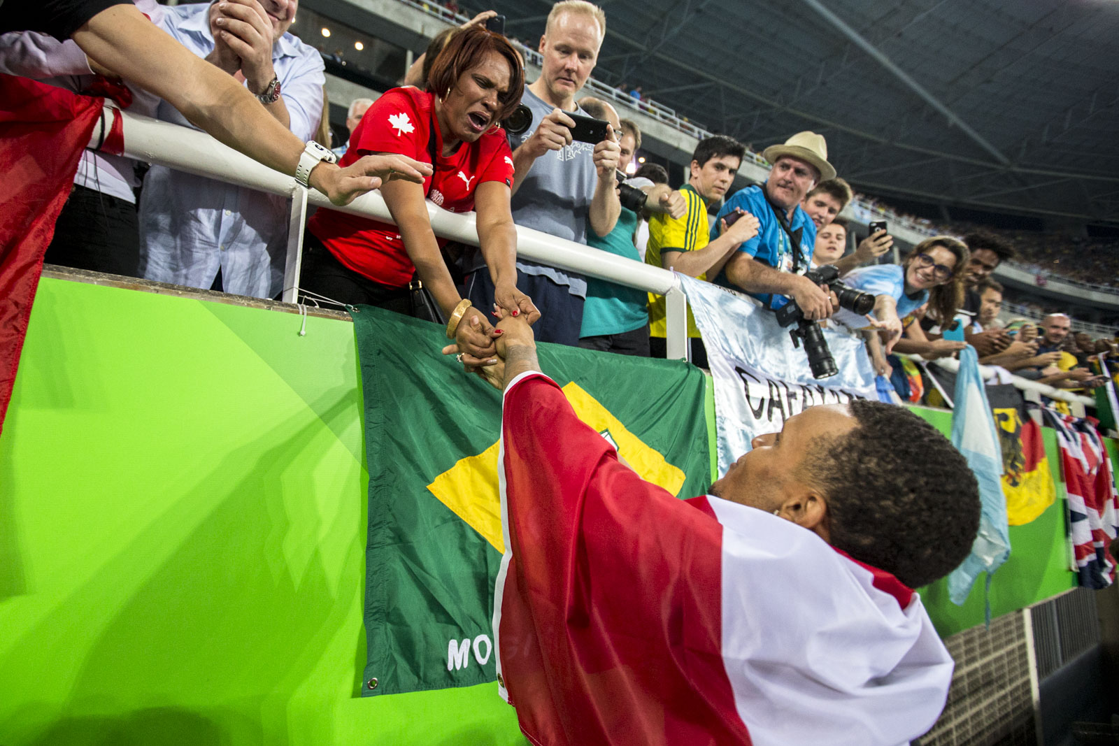 Andre DeGrasse finds his mother after winning olympic bronze in the mens 100m sprint, Rio de Janeiro, Brazil, Sunday August 14, 2016.    COC Photo/David Jackson