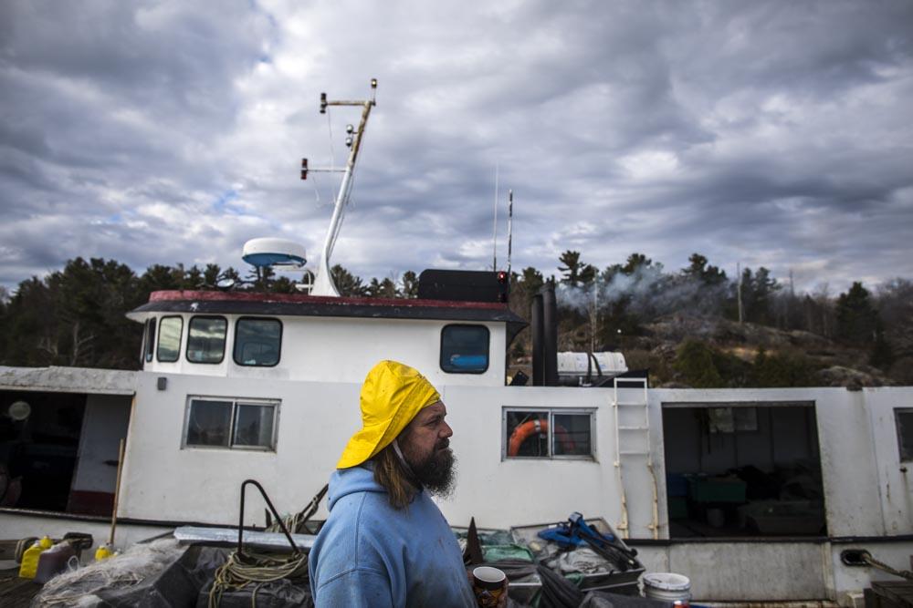 Mike ranta works on play fair II commercial fishing o Herbert fishery on Georgian Bay, Lake Huron, Ontario. Photo/ David Jackson