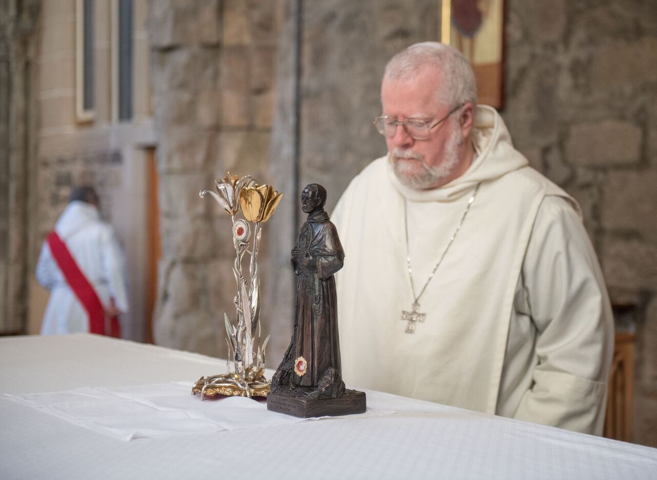 Fr. Abbot praying before S Maximilian's relics 2017.jpg