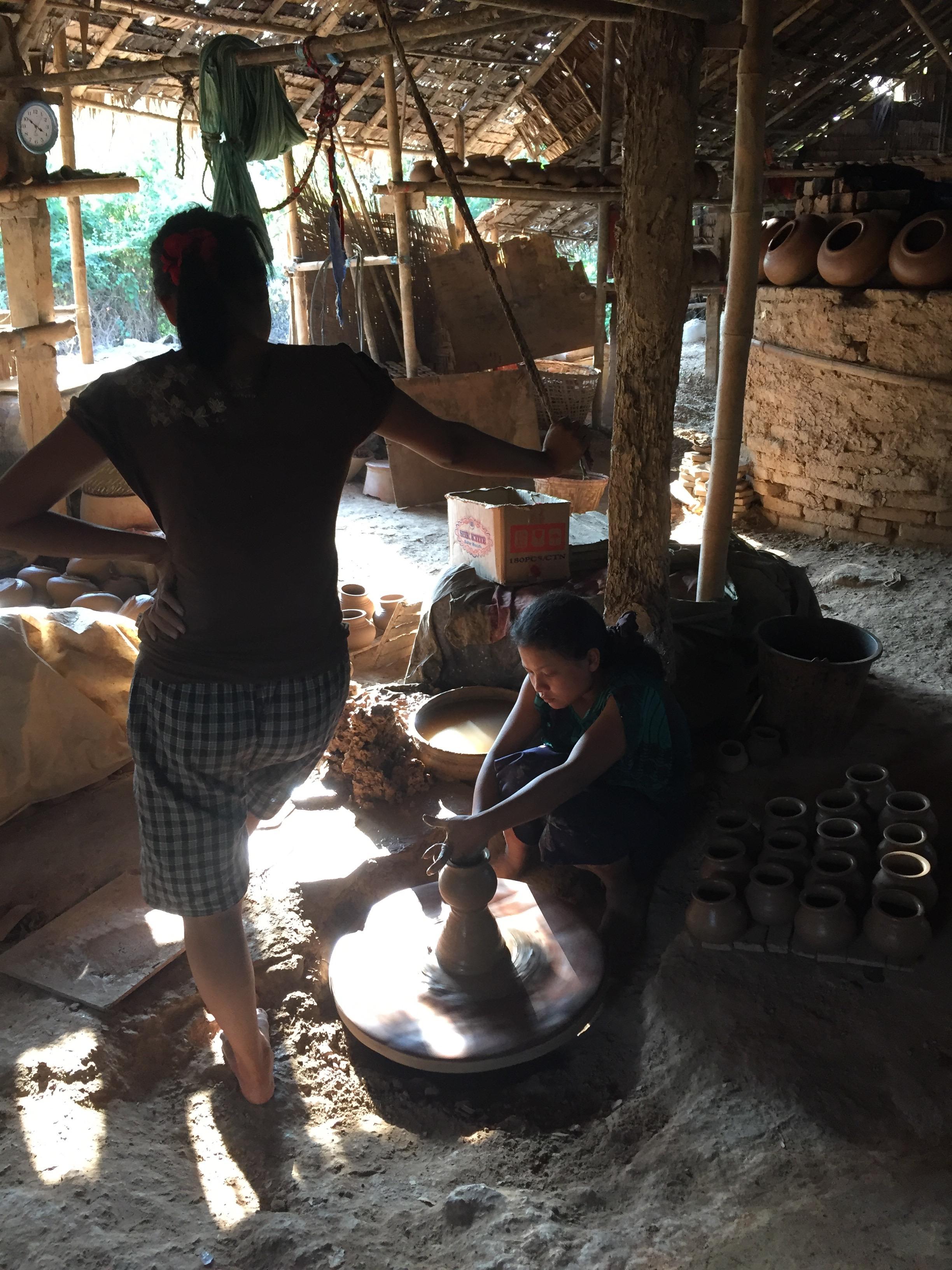 Potters in their workshop in the village of Twante.