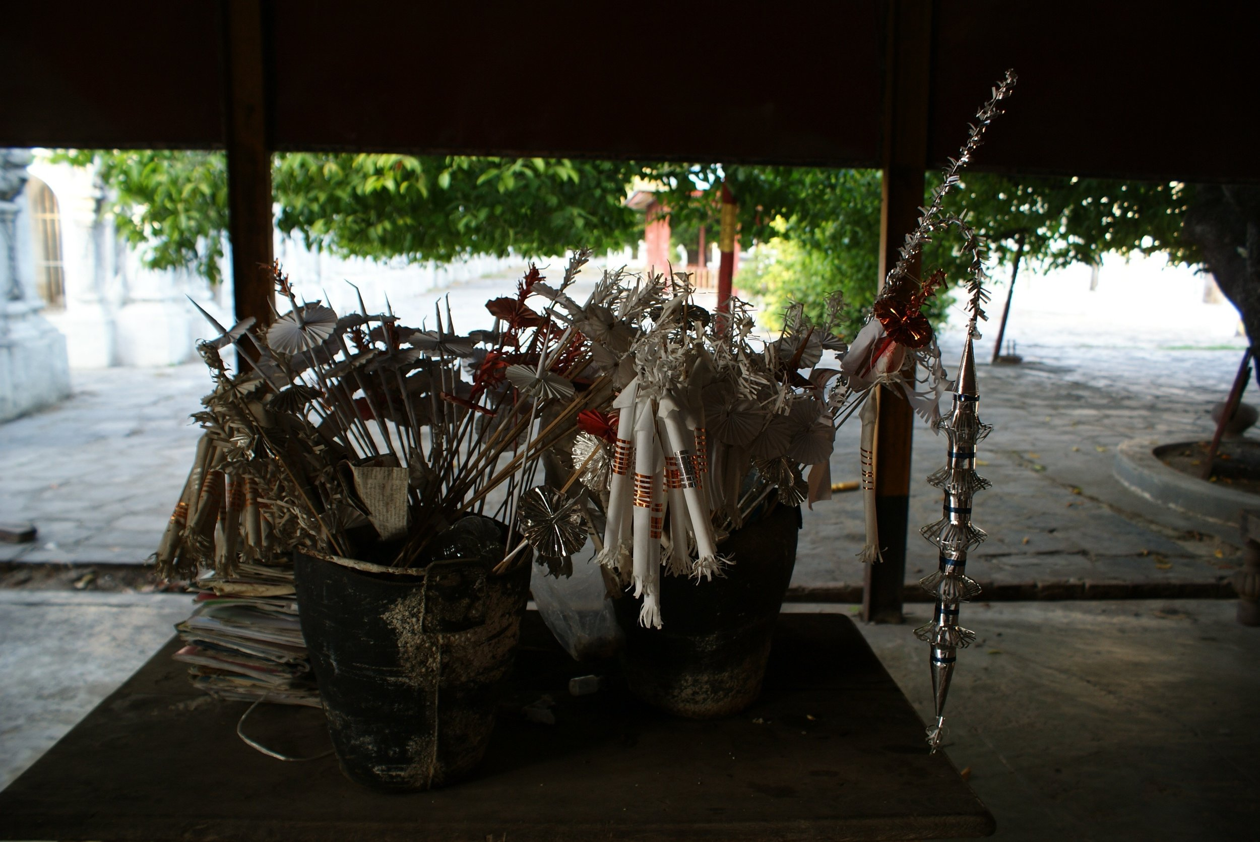 Intricately folded paper offerings for sale at the temple.  They will be burned as a blessing and gifts for the deceased..