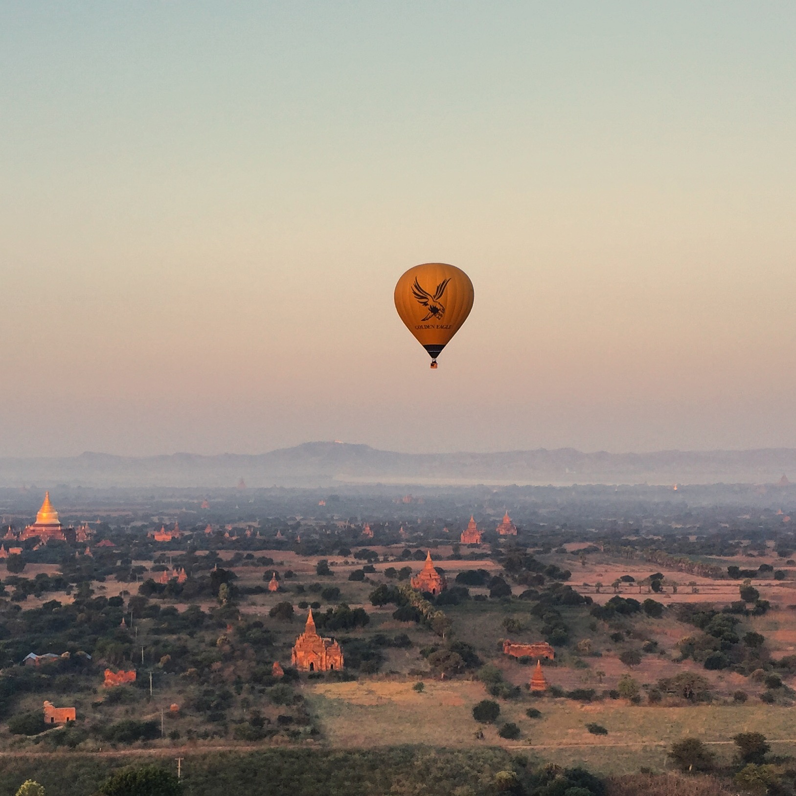 The best view of Bagan is from a hot air balloon at sunrise.  It's fun to watch the town awaken, the shepherds leading their sheep and cows to the pasture, the monks and nuns in search of alms, and the farmers tending to their crops.  It's a quiet morning, as there are very few motorized vehicles at that hour.