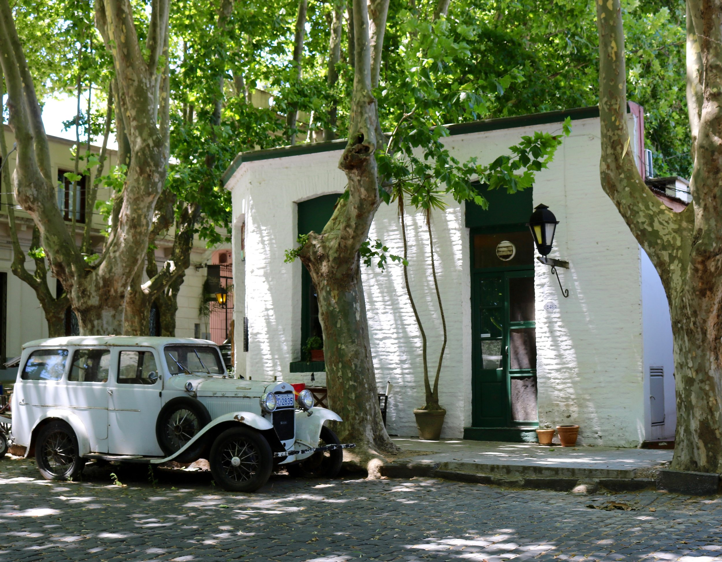 """The cobblestone historical part of Colonia is filled with old cars, many of which have been upcycled and turned into planters, nonetheless they help to create a lovely """"old-school"""" vibe throughout the city."""