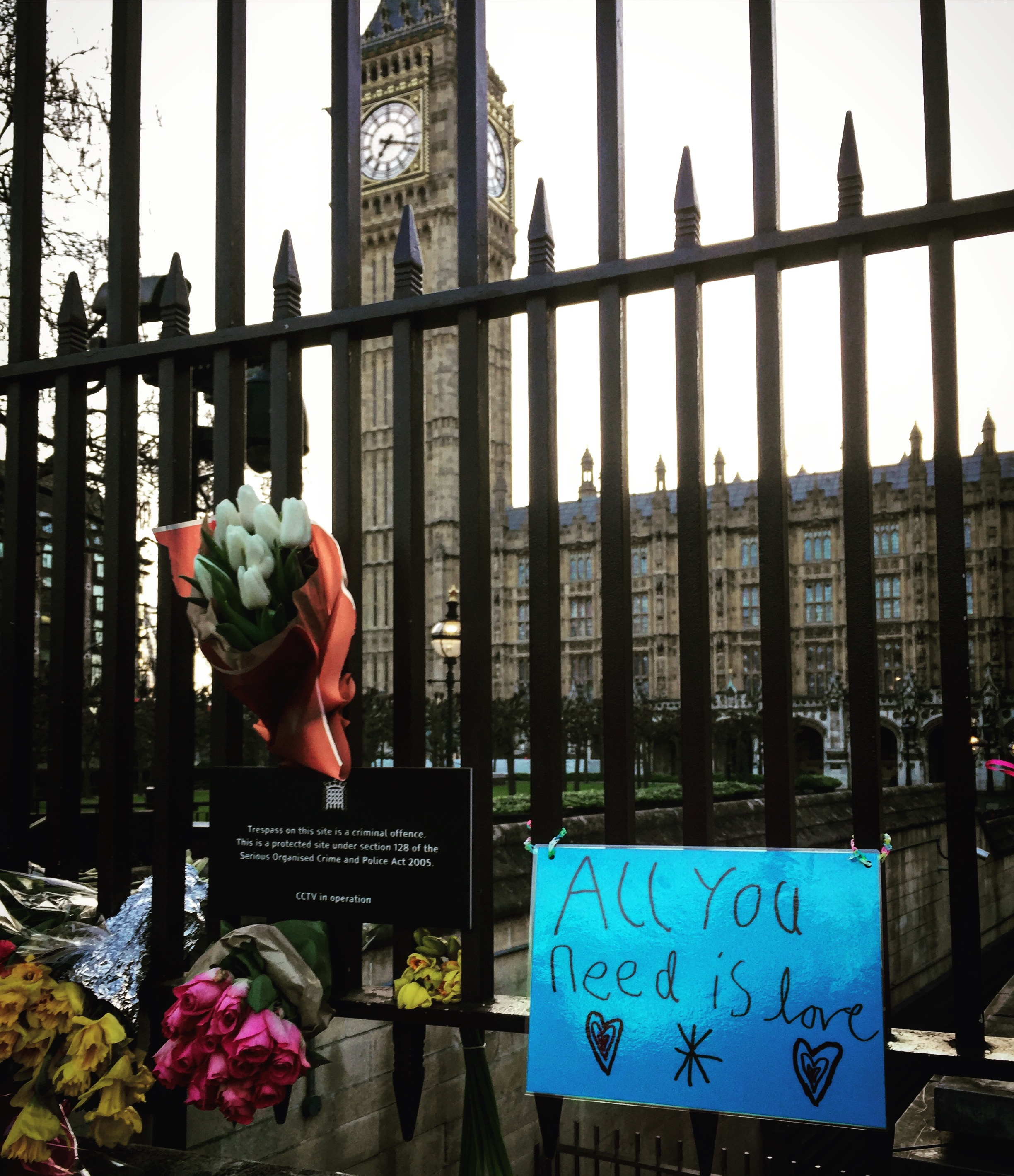 A few of the flowers and messages left outside the gates of Parliament after the March 22 attack.