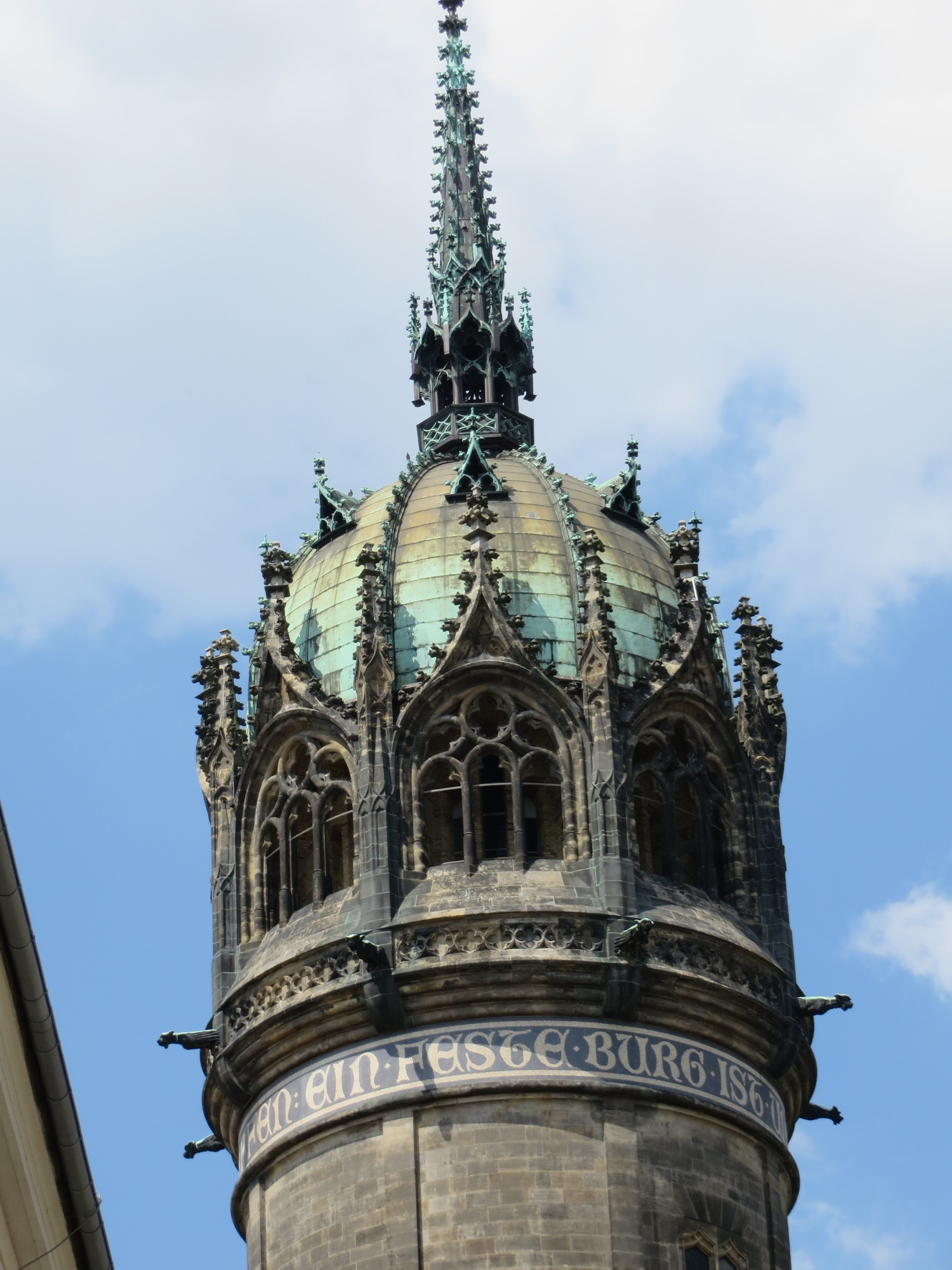 Dome on the Tower of the Castle Church, Wittenberg. Text of luther's famous hymn visible beneath cap