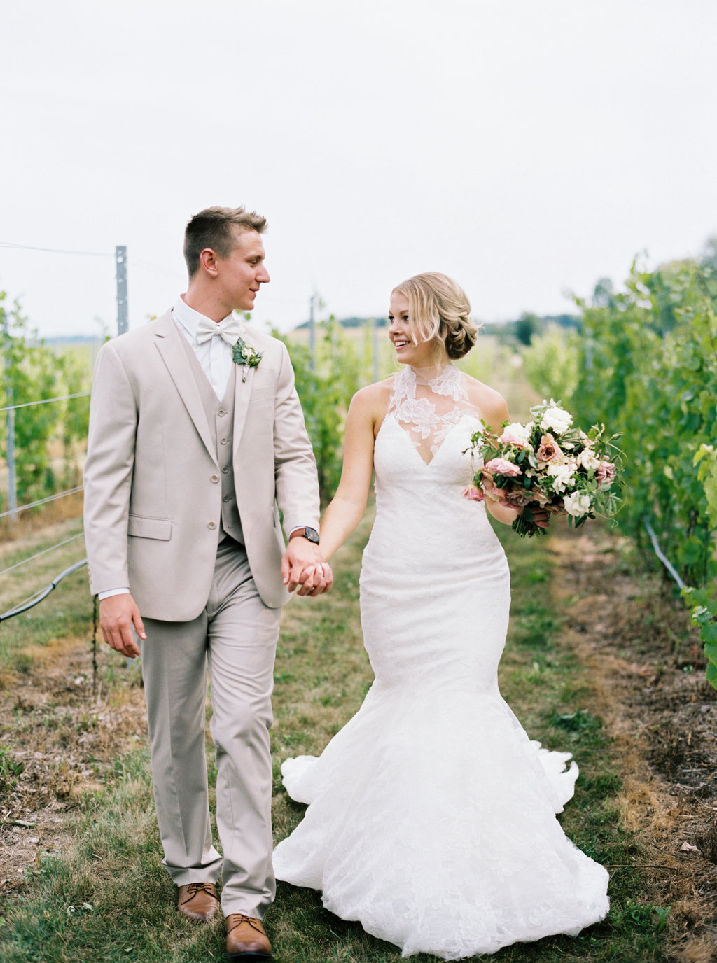 Bride and groom vineyard portraits for an aurora cellars