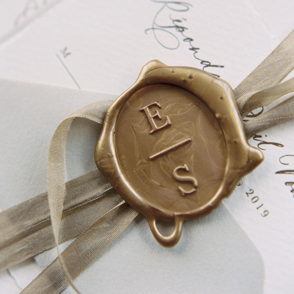 Monogram wax seals for wedding invitations.