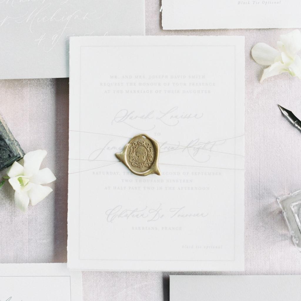 Assembly details for wedding invitations. Custom wax seals, twine, ribbon, vellum, etc.
