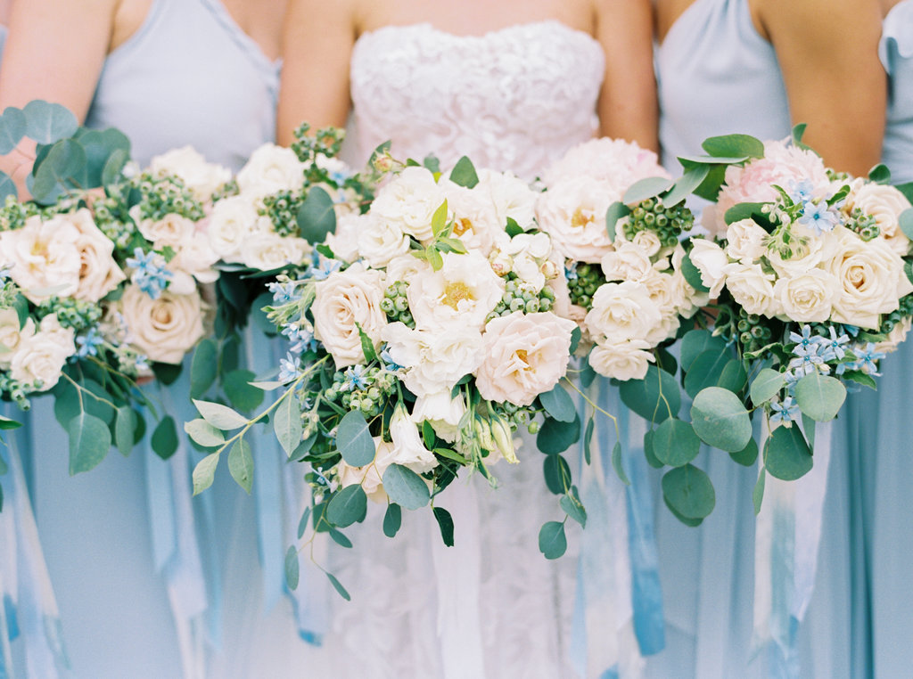 Dusty blue bridesmaid dresses. Bridesmaid bouquets with eucalyptus.