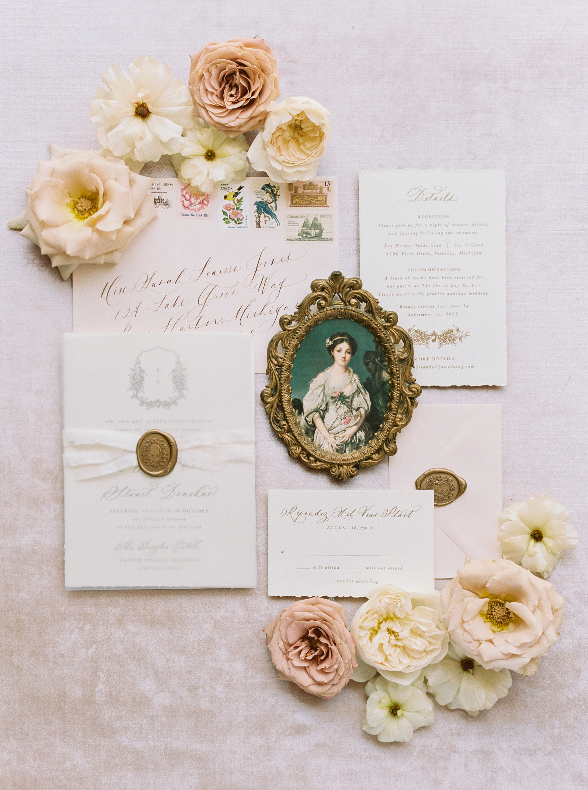 Romantic semi-custom wedding invitation suite. Antique gold wax seals, silk ribbon, vellum overlay, gold calligraphy, and blush envelopes.