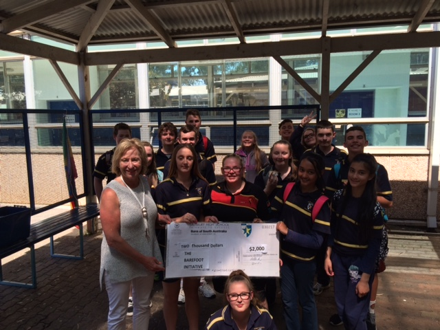 Year eight students presenting the $2500 raised by their incredible efforts