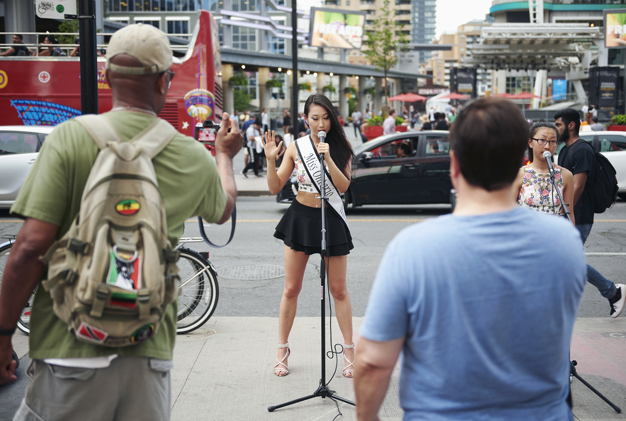 Alice Li, reigning Miss Intercontinental Canada 2018, performs at Yonge and Dundas Square to collect donations for the Children's Wish Foundation.