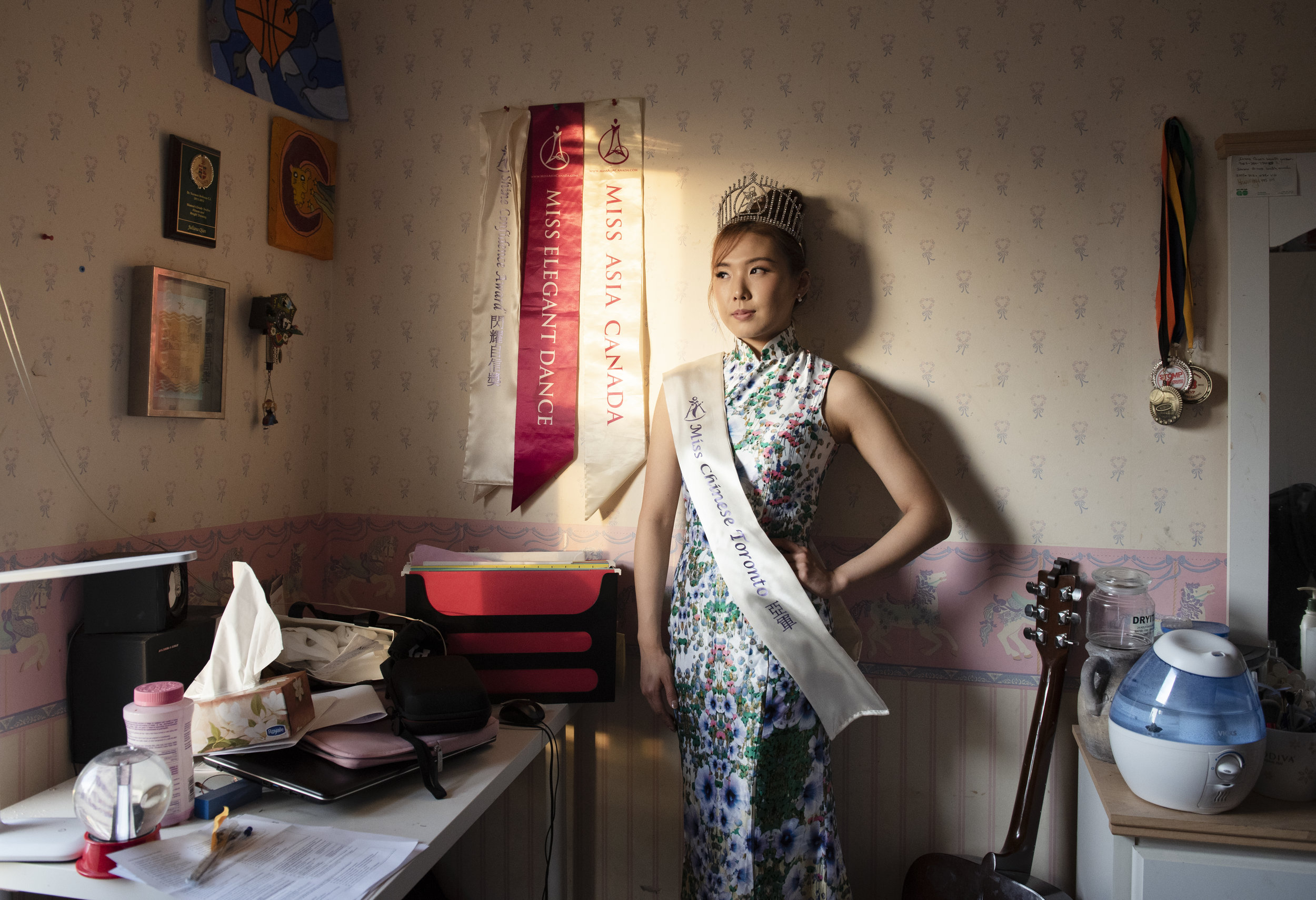 Juiliana Qian, 24, works as an administrator, but identifies more as a dancer and model. She was the first runner up for Miss Chinese Toronto in 2015. She still performs and models, but is not sure if she wants to do another pageant in the future. Shot in Juliana's home in Scarborough, on April 12, 2019.
