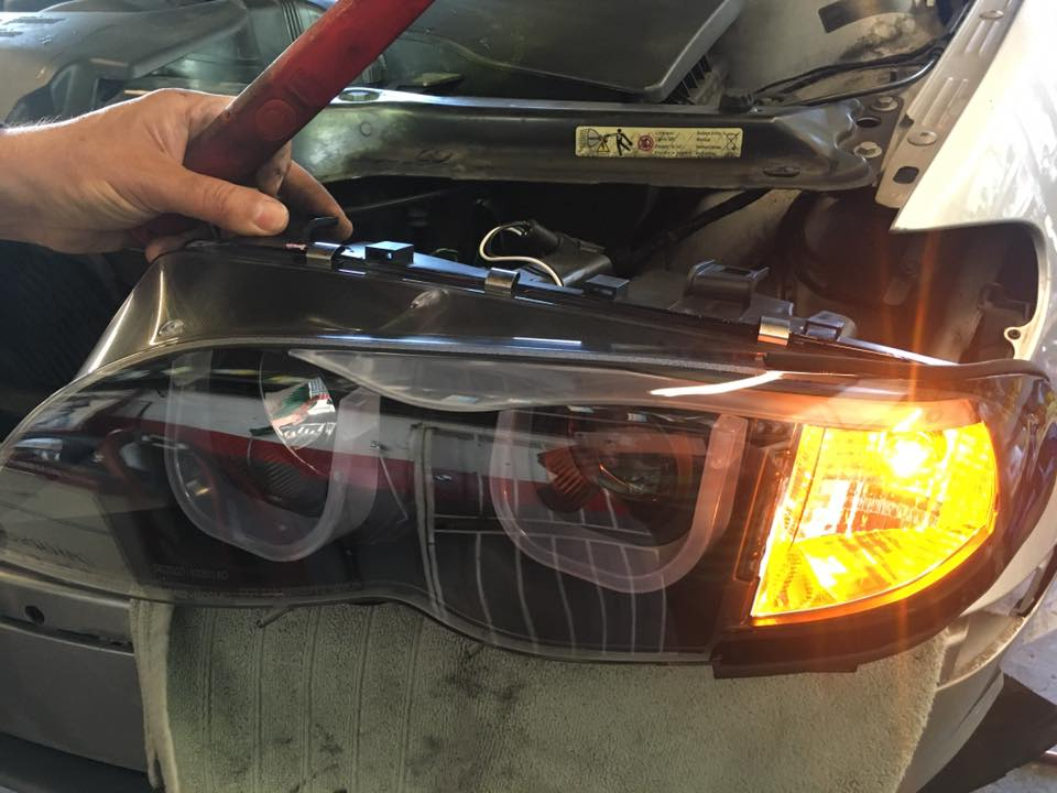 Replace car headlights with HID lights at Audiosport