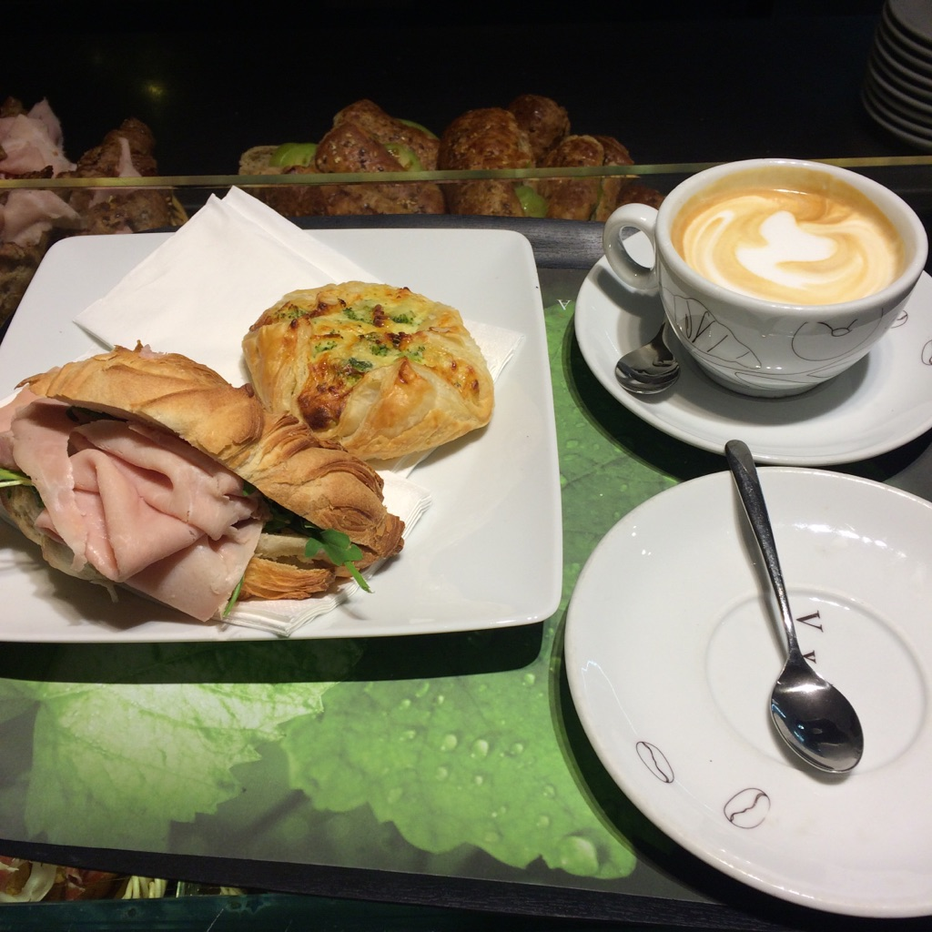 I got the broccoli, egg and cheese puff pastry and cappuccino and Isaac had the sammie.