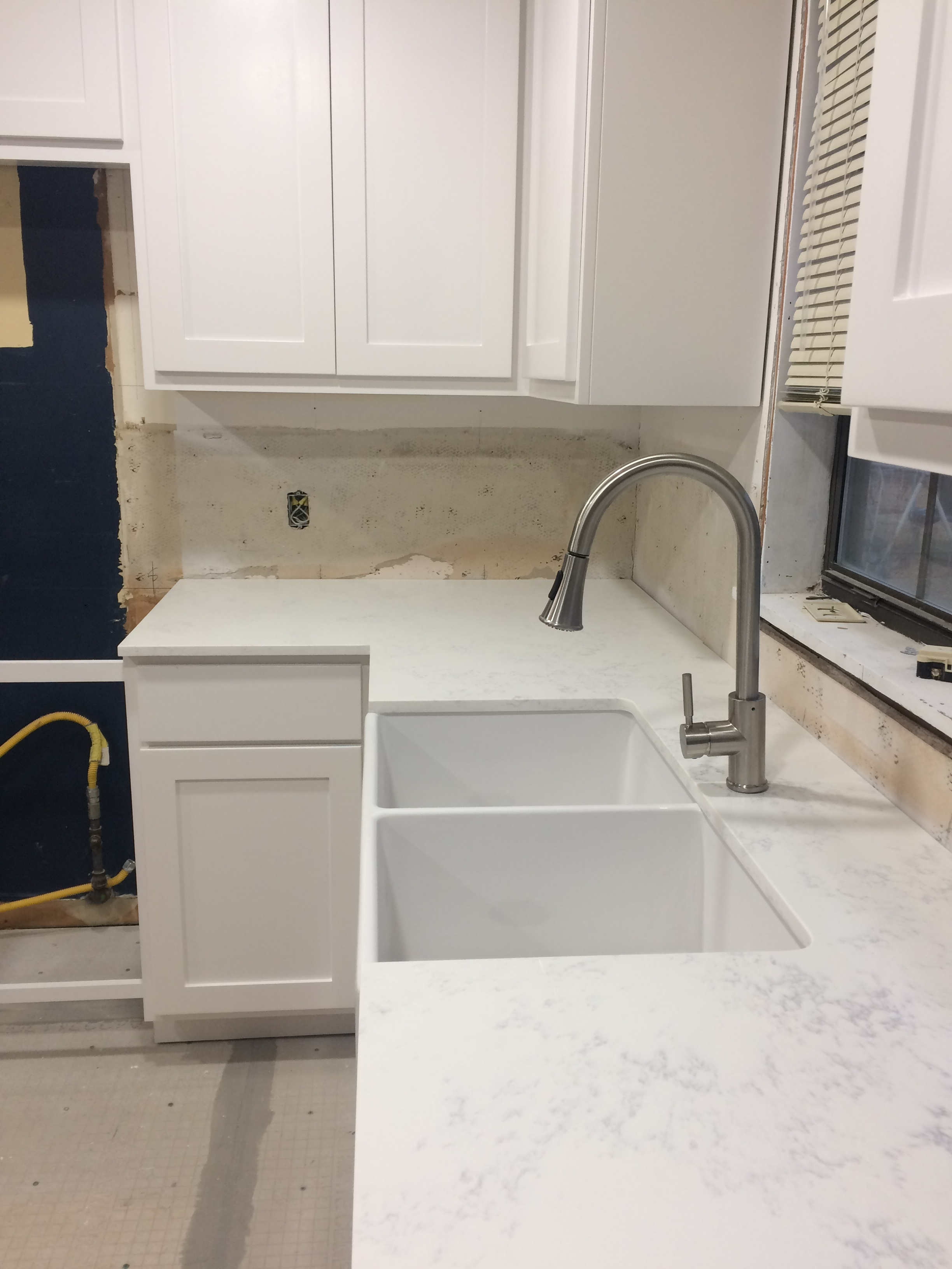 The cabinets, countertops, sink, and backerboard are in!