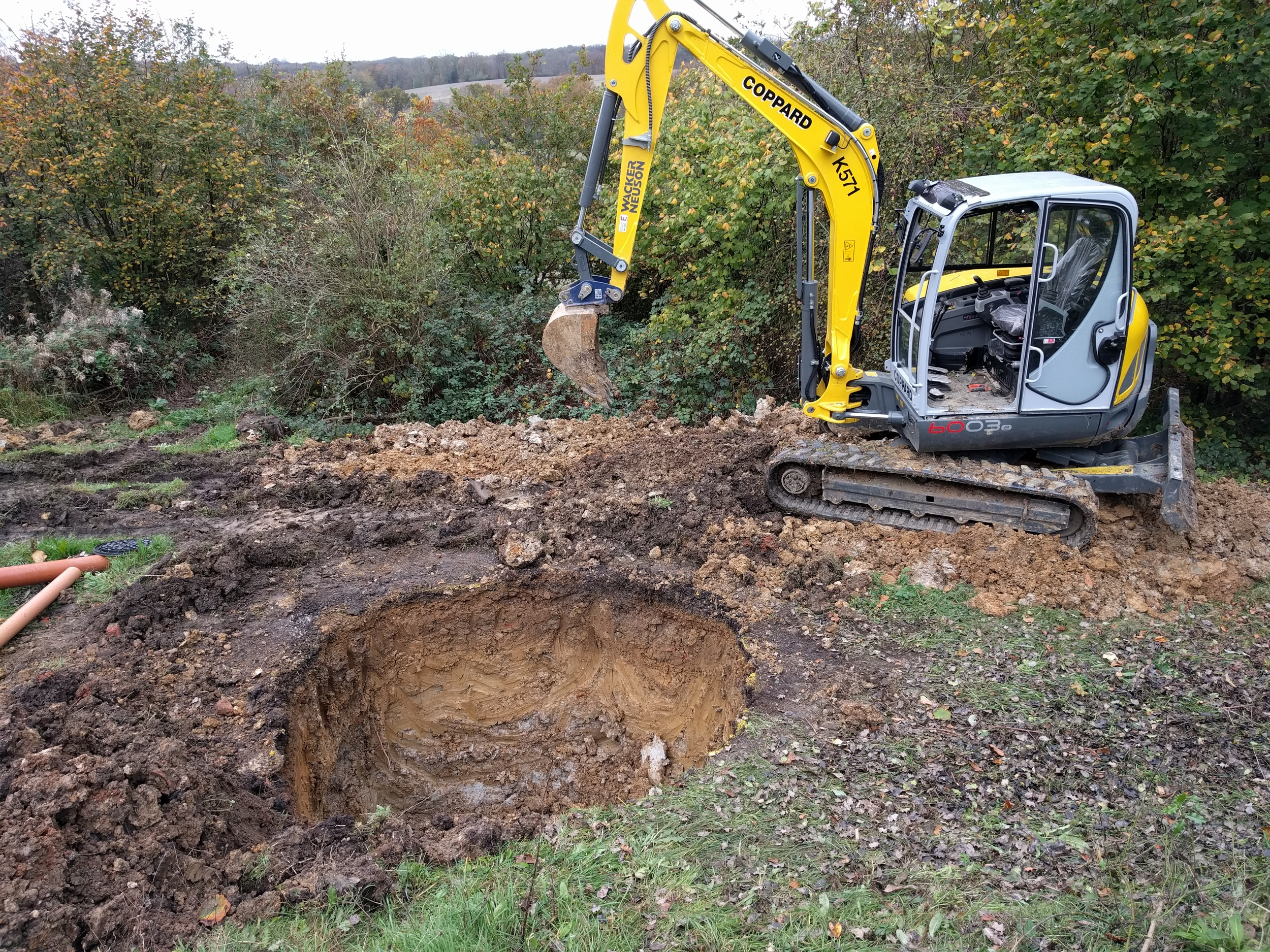 Meanwhile, in the  outside  filth, eight cubic meters of clay makes way for a biodigester, which will munch through the liquid waste which can't be used as cattle feed.