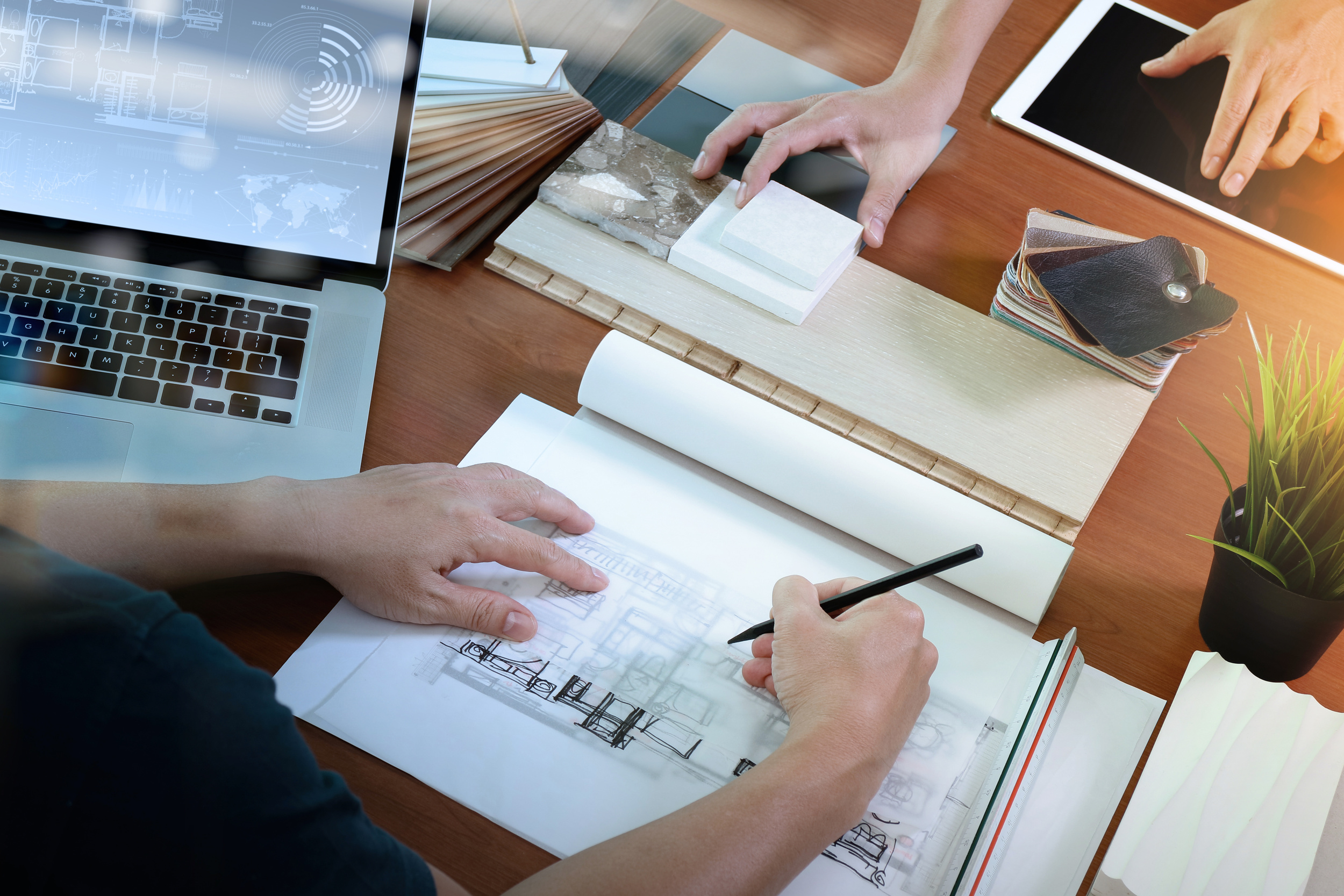 designer working at her desk with sketches