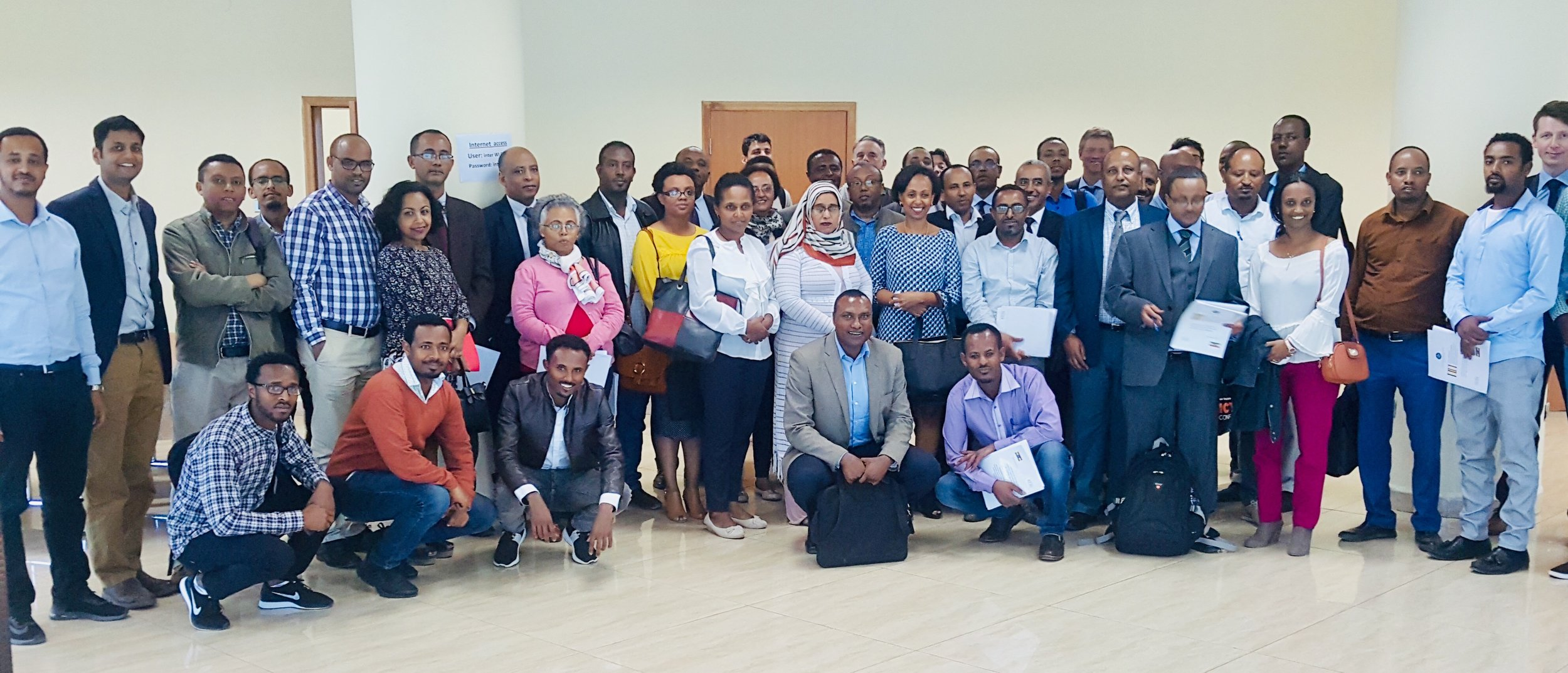 participants in workshop launching ethiopia ncdi poverty report.