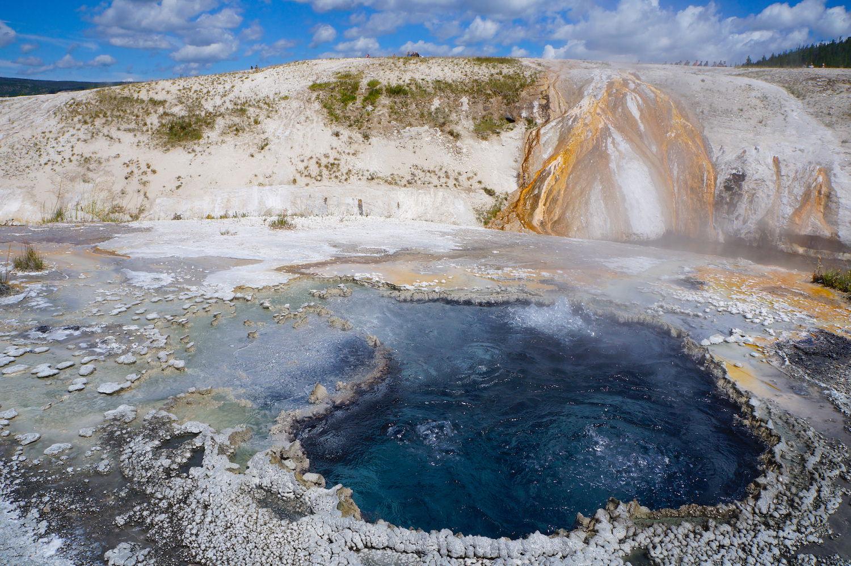 One of many spectacular hot springs along the boardwalk near  Old Faithful  ,  Yellowstone's biggest, regular geyser.