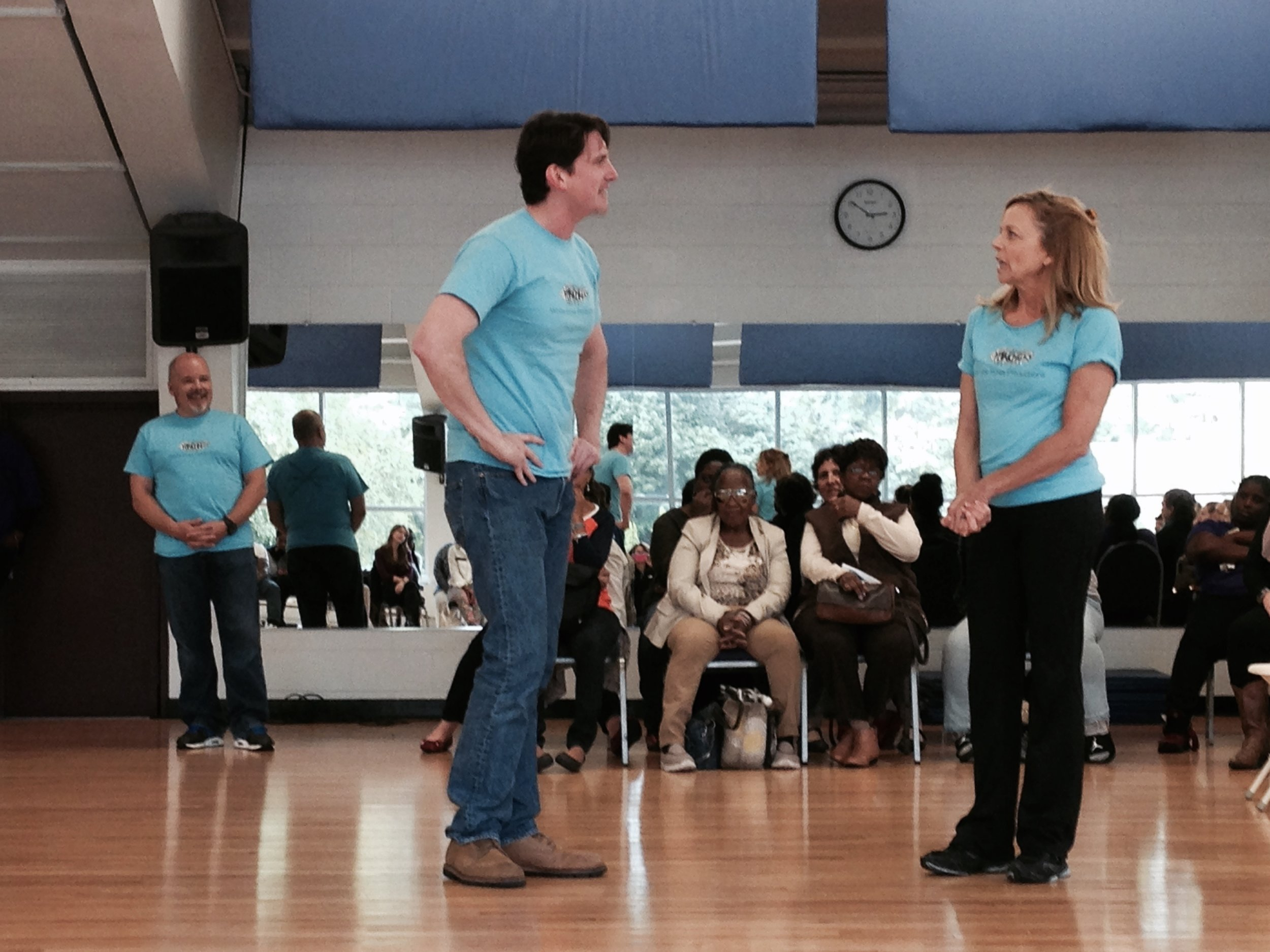 Bob Stineman and Michelle Pauls perform a scenario for the YMCA under Benjamin Lloyd's direction.