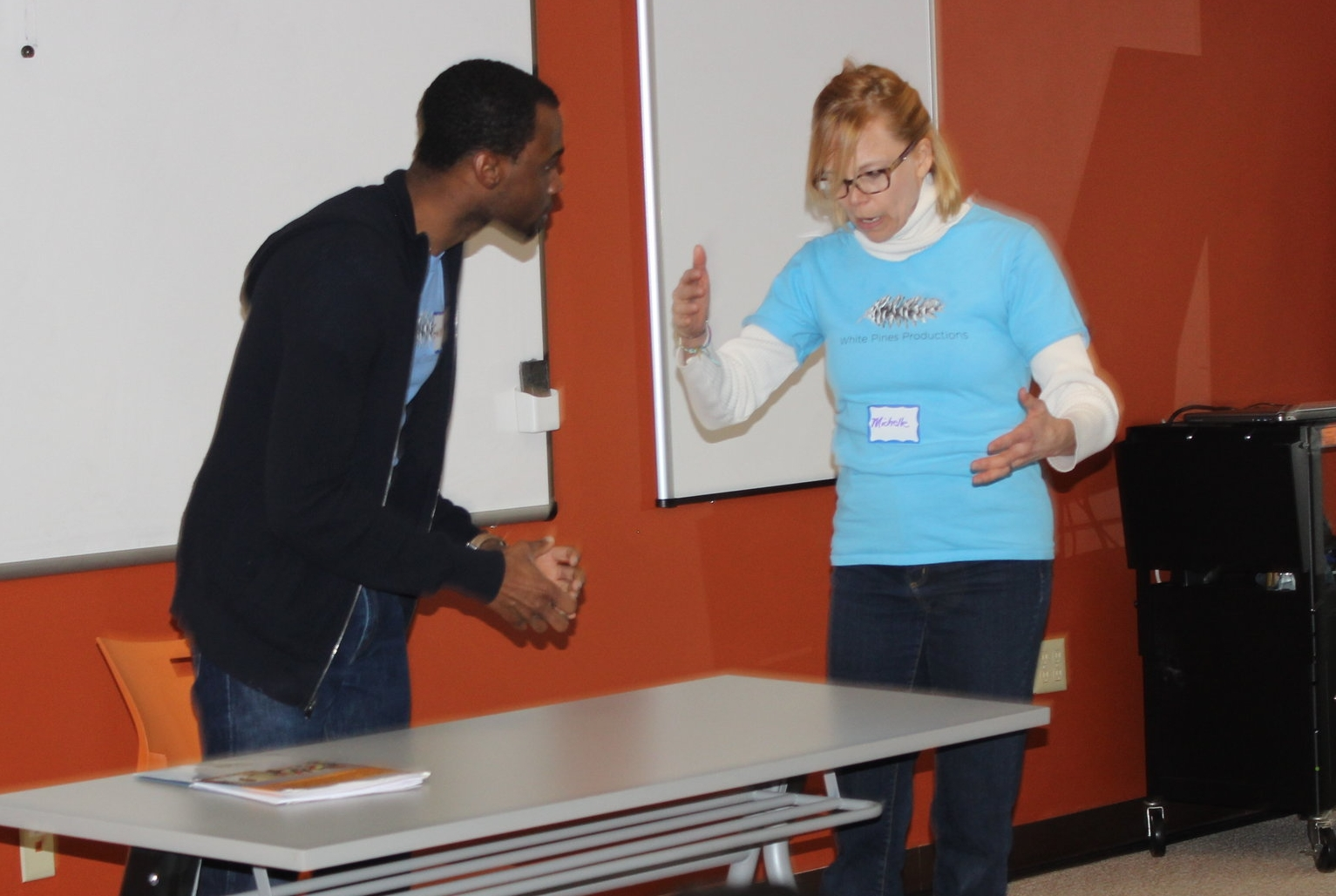 Gavin Whitt and Michelle Pauls perform a scenario for University City District.