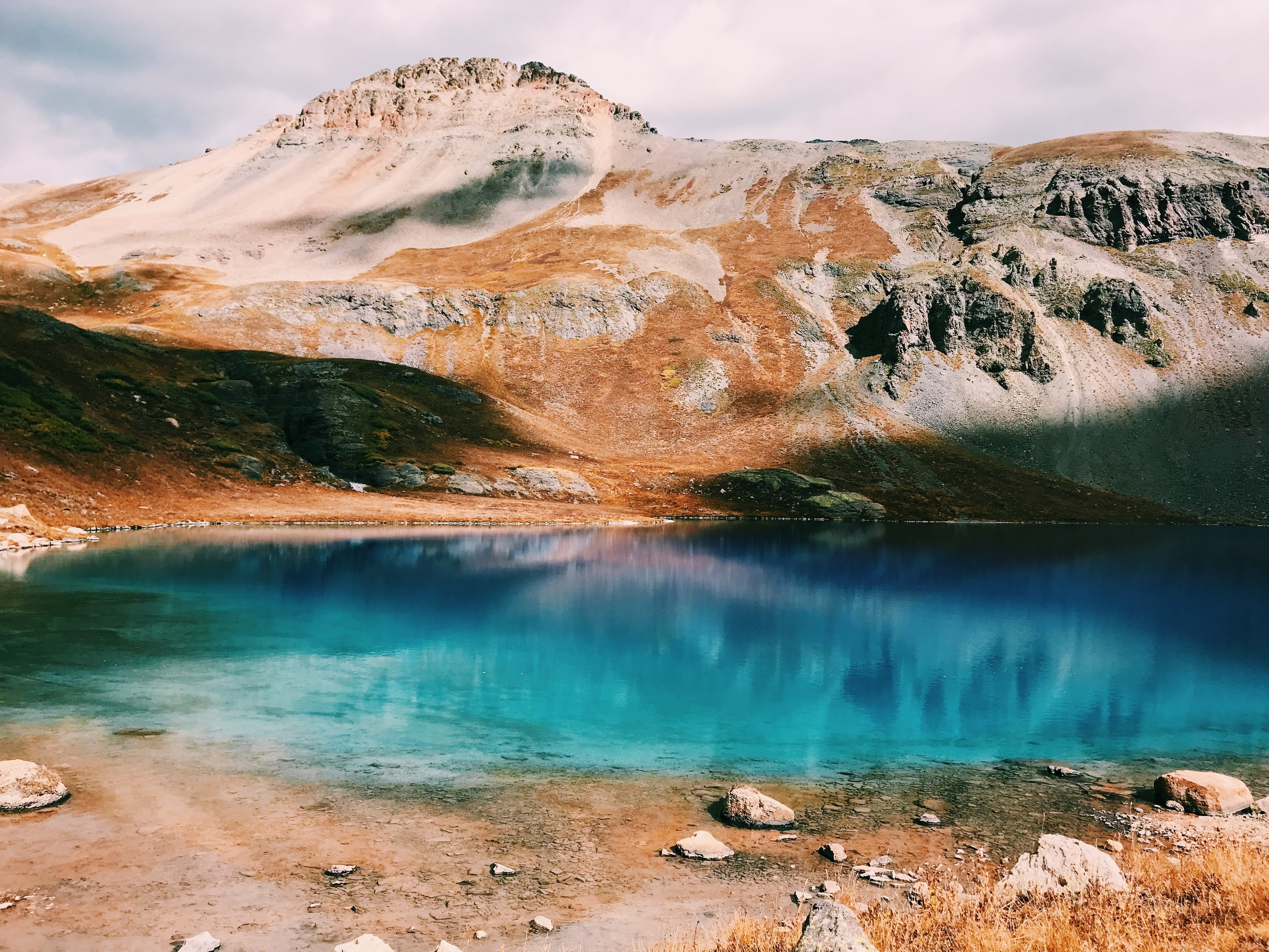 Silverton, Colorado in the San Juan National Forest. Ice Lake's cerulean colors must be witnessed firsthand.